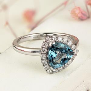 Halo Swiss Blue Topaz Diamond Ring in 14K White Gold with 2.10 carat Trillion Swiss Blue Topaz