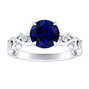 DAISY Blue Sapphire Engagement Ring In 14K White Gold With 0.30 Carat Round Stone